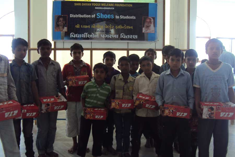 Distribution of Shoes to Students at Shri Dhyanyogiji Welfare Foundation 2013
